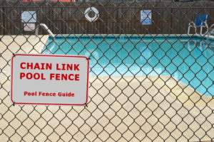 Chain link swimming pool fence barrier
